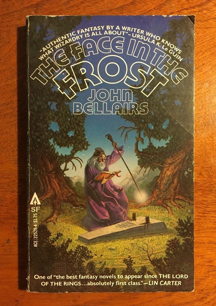 cover image of a wizard in a purple robe over a tombstone, reading from a book