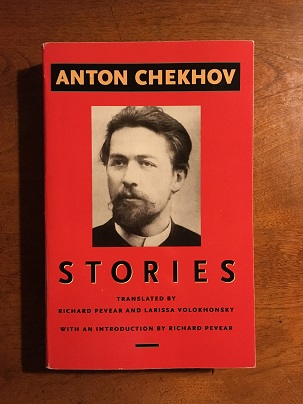 cover image of a portrait of Anton Chekhov, surrounded by fire-engine red